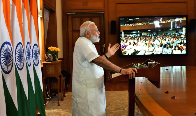 Prime Minister Narendra Modi addresses the 5th International Convention of SPIC MACAY, via video conferencing in New Delhi on June 5, 2017. - Narendra Modi
