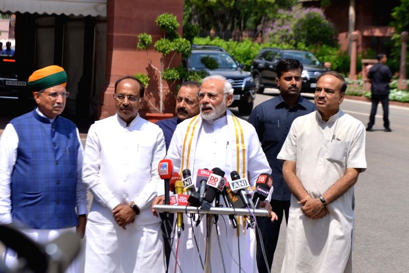 Prime Minister Narendra Modi addresses the media along with Union Ministers Ananth Kumar, Jitendra Singh, Vijay Goel and Arjun Ram Meghwal, ahead of the Monsoon Session of Parliament, in ... - Narendra Modi, Ministers Ananth Kumar, Jitendra Singh, Vijay Goel and Arjun Ram Meghwal