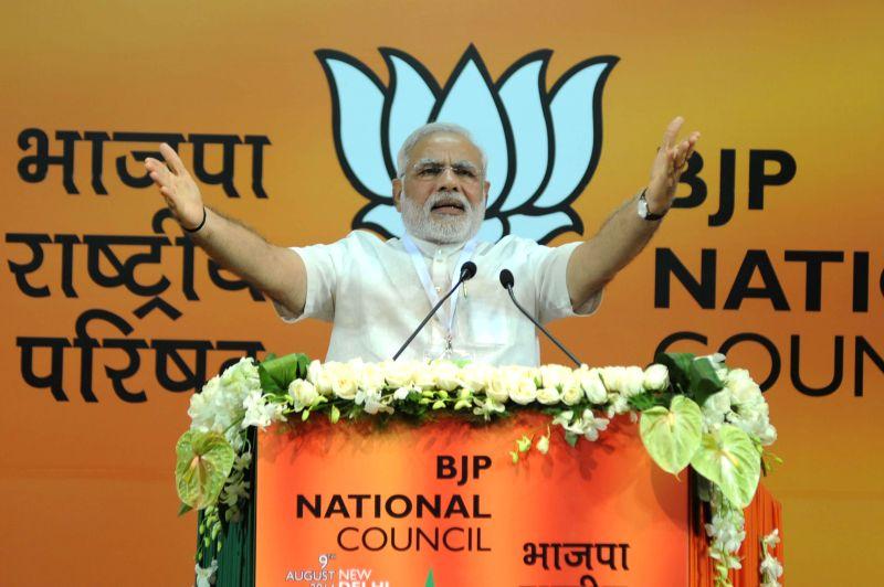 Prime Minister Narendra Modi addressing at the BJP National Council meeting in New Delhi on Aug 9, 2014. - Narendra Modi