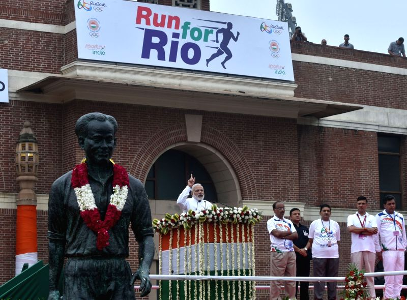 "Prime Minister Narendra Modi addressing at the flagging off ceremony of ""Run For Rio"", at Major Dhyan Chand National Stadium, in New Delhi on July 31, 2016. Minister of State for ... - Narendra Modi and Rajiv Yadav"