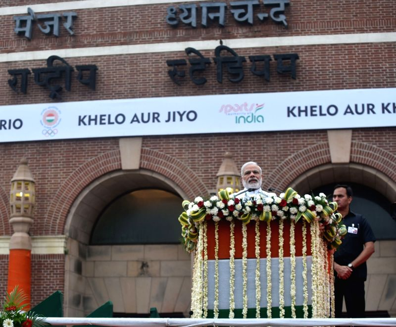 "Prime Minister Narendra Modi addressing at the flagging off ceremony of ""Run For Rio"", at Major Dhyan Chand National Stadium, in New Delhi on July 31, 2016. - Narendra Modi"