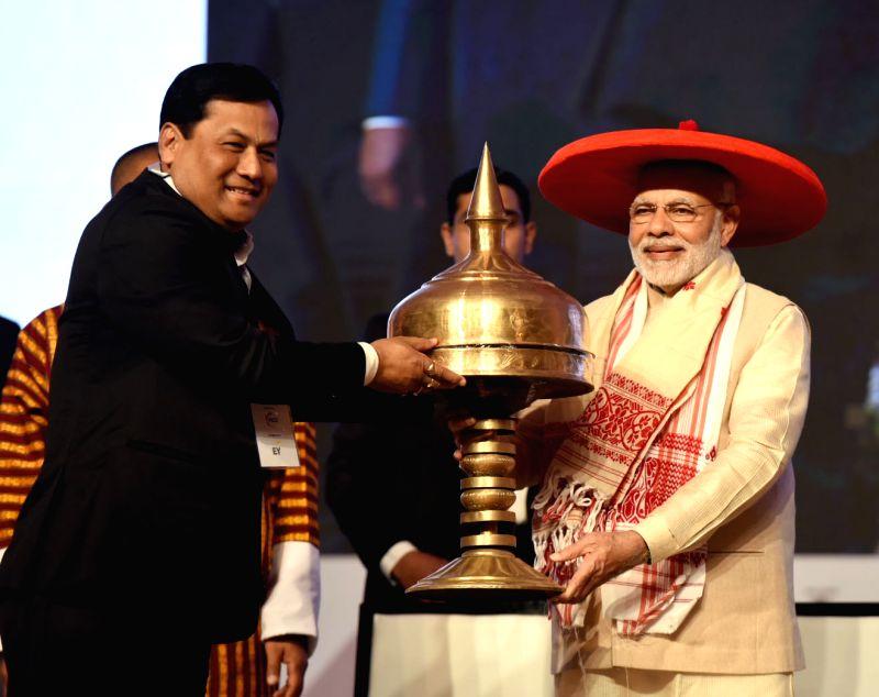 Prime Minister Narendra Modi and Assam Chief Minister Sarbananda Sonowal at the Advantage Assam- Global Investors Summit 2018 in Guwahati on Feb 3, 2018. - Narendra Modi