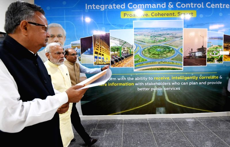 Prime Minister Narendra Modi and Chhattisgarh Chief Minister Raman Singh during the inauguration of Integrated Command and Control Centre for Naya Raipur Smart City, in Raipur on June 14, ... - Narendra Modi and Raman Singh