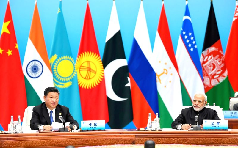 Prime Minister Narendra Modi and Chinese President Xi Jinping at the Plenary Session of the Shanghai Cooperation Organisation (SCO) Summit in Qingdao, China on June 10, 2018. - Narendra Modi