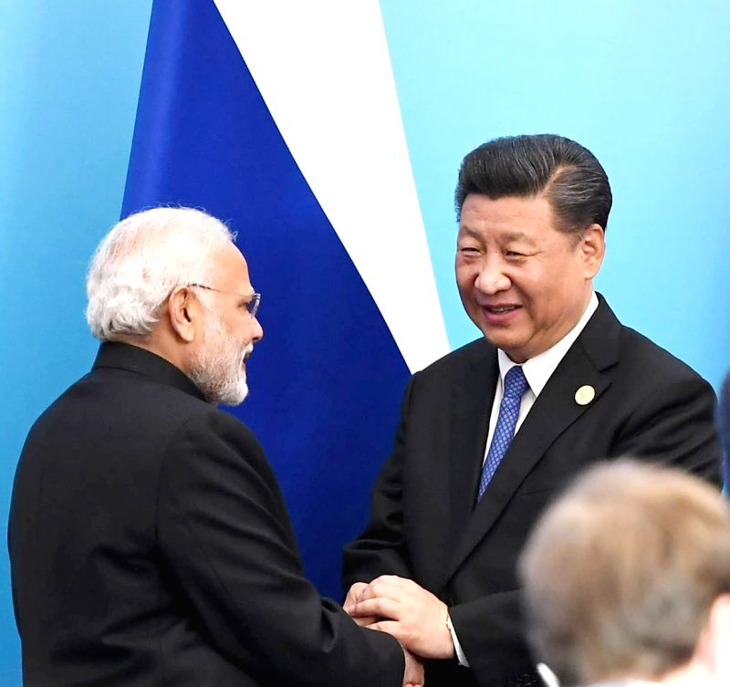 Prime Minister Narendra Modi and Chinese President Xi Jinping at the Signing Ceremony of the Shanghai Cooperation Organisation (SCO) Summit, in Qingdao, China on June 10, 2018. - Narendra Modi