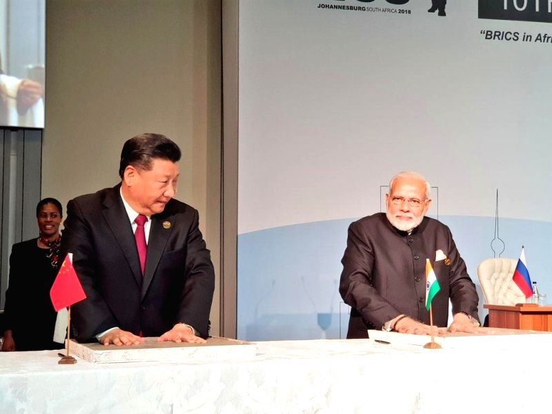 Prime Minister Narendra Modi and Chinese President Xi Jinping leave their hand impression on clay, for a symbolic demonstration of our connect to the Cradle of Humankind in Maropeng in ... - Narendra Modi