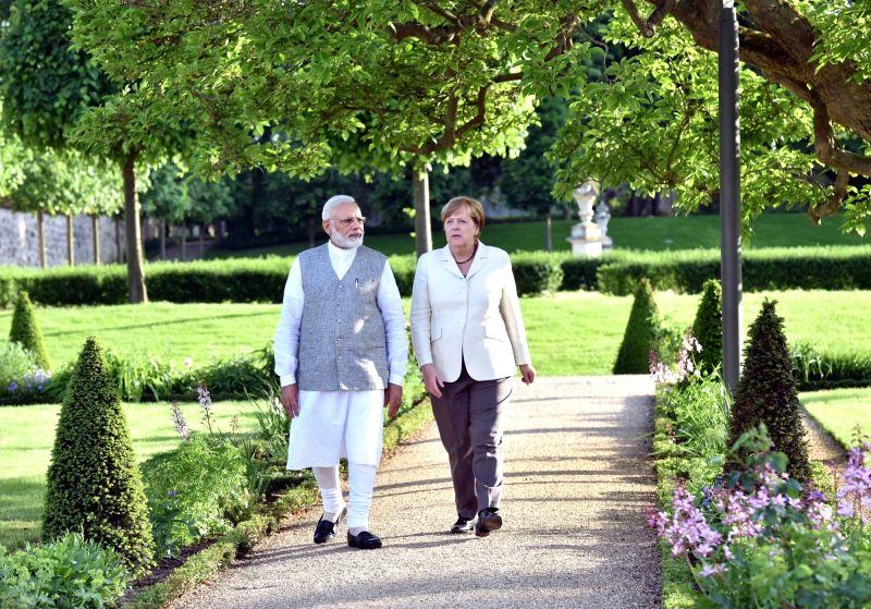 Prime Minister Narendra Modi and German Chancellor  Angela Merkel during a meeting at Schloss Meseberg in Berlin, Germany on May 29, 2017. - Narendra Modi