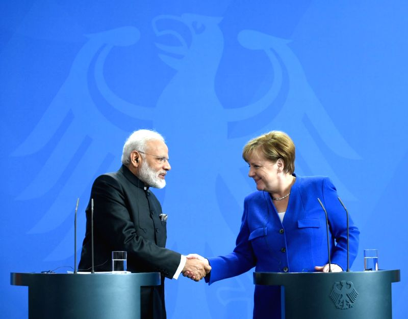 Prime Minister Narendra Modi and German Chancellor Dr. Angela Merkel at the Joint Press Statements, in Berlin, Germany on May 30, 2017. - Narendra Modi