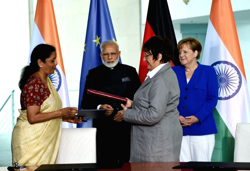 Prime Minister Narendra Modi and German Chancellor, Dr. Angela Merkel witnesses the exchange of MoUs/JDIs between India and Germany, in Berlin, Germany on May 30, 2017. - Narendra Modi
