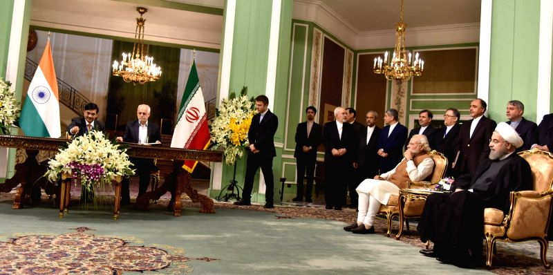 Prime Minister Narendra Modi and Iranian President Hassan Rouhani witness the signing of agreements between India and Iran, in Tehran, Iran on May 23, 2016. - Narendra Modi and Hassan Rouhani