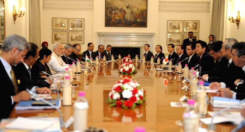 Prime Minister Narendra Modi and Japanese Prime Minister Shinzo Abe at the delegation level talks between India and Japan, at Hyderabad House, in New Delhi on Dec 12, 2015. - Narendra Modi