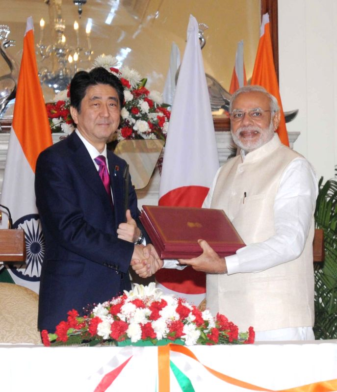 Prime Minister Narendra Modi and Japanese Prime Minister Shinzo Abe at the MoU signing ceremony, in New Delhi on Dec 12, 2015. - Narendra Modi