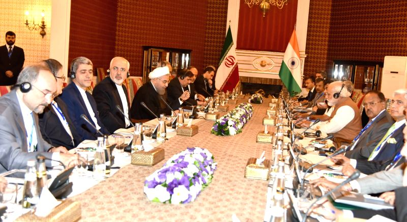 Prime Minister Narendra Modi and President of Iran Hassan Rouhani at the delegation level talks, in Tehran, Iranon May 23, 2016. - Narendra Modi and Hassan Rouhani