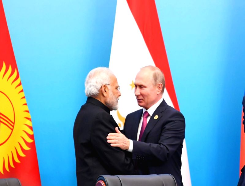 Prime Minister Narendra Modi and Russian President Vladimir Putin at the Signing Ceremony of the Shanghai Cooperation Organisation (SCO) Summit, in Qingdao, China on June 10, 2018. - Narendra Modi