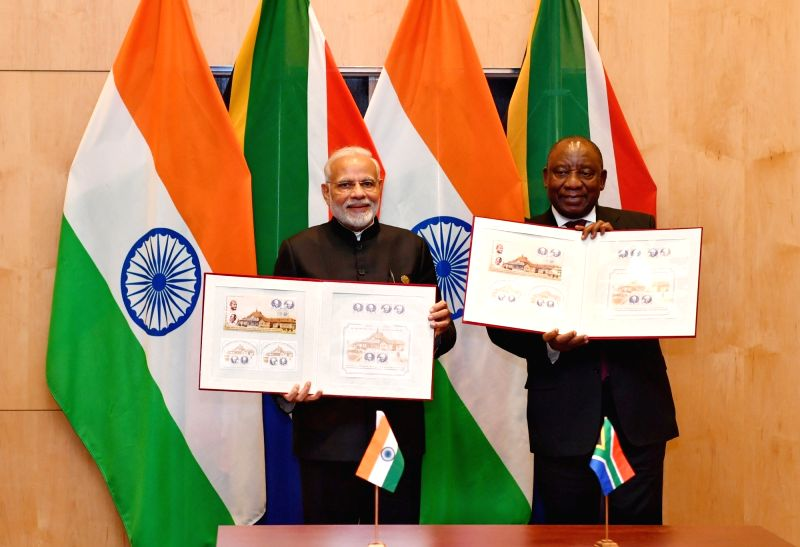 Prime Minister Narendra Modi and South African President Cyril Ramaphosa releases the India-South Africa Commemorative Stamps, in Johannesburg, South Africa on July 27, 2018. - Narendra Modi