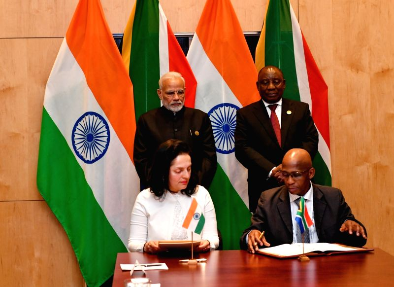 Prime Minister Narendra Modi and South African President Cyril Ramaphosa witnesses the signing of Memorandums of Understanding (MoUs) between India and South Africa, in Johannesburg, ... - Narendra Modi