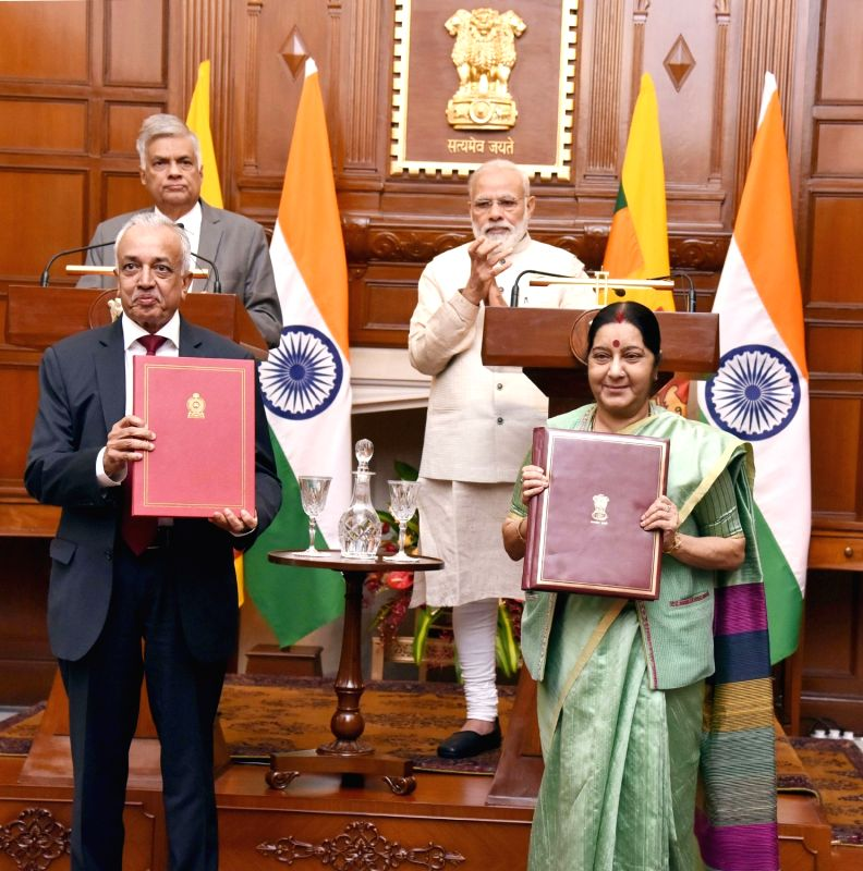 Prime Minister Narendra Modi and Sri Lankan Prime Minister Ranil Wickremsinghe witness the exchange of agreements at Hyderabad House, in New Delhi on April 26, 2017. Also seen External ... - Narendra Modi and Sushma Swaraj