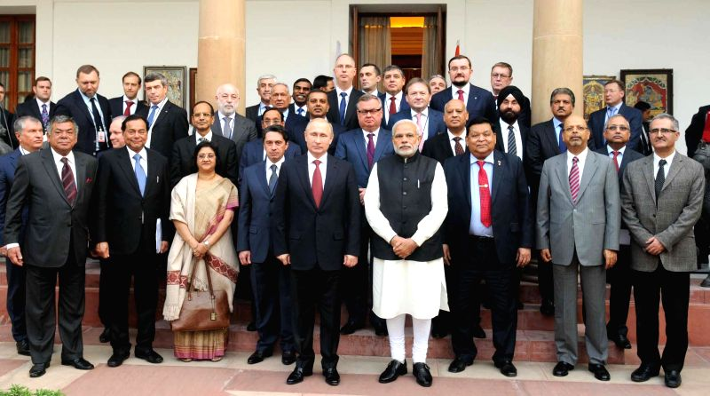 Prime Minister Narendra Modi and the President of the Russian Federation, Vladimir Putin after interaction with the CEOs, in New Delhi on Dec 11, 2014. - Narendra Modi
