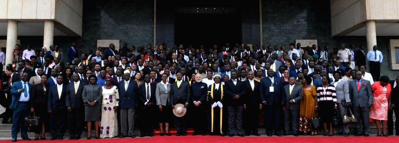 Prime Minister Narendra Modi and Uganda President Yoweri Kaguta Museveni with Members of Ugandan Parliament, in Kampala, Uganda on July 25, 2018. - Narendra Modi