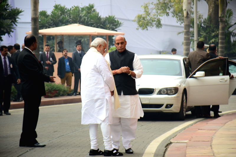 Prime Minister Narendra Modi and Union Home Minister Rajnath Singh in discussion after paying homage to Parliament attack martyrs on its 13th anniversary in New Delhi on Dec. 13, 2014. - Narendra Modi and Rajnath Singh