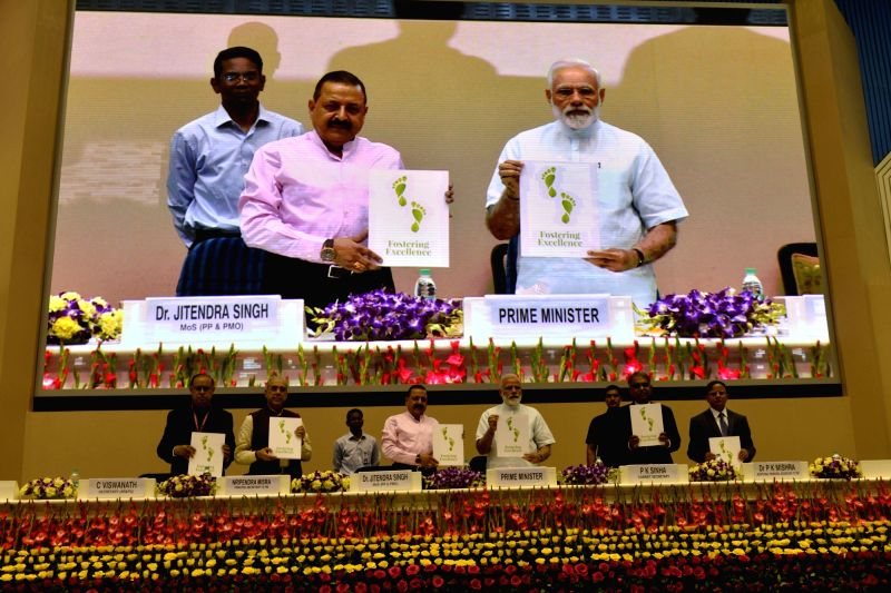 Prime Minister Narendra Modi and Union Minister Dr. Jitendra Singh at the 11th Civil Services Day programme at Vigyan Bhawan, in New Delhi on April 21, 2017. - Narendra Modi and Jitendra Singh