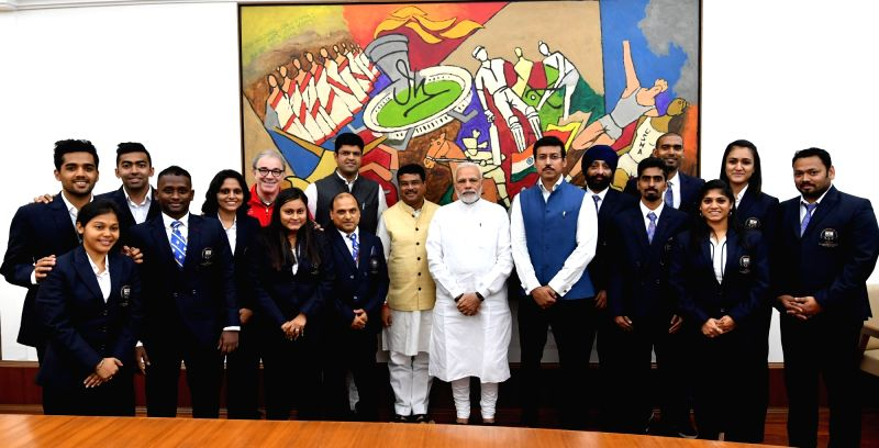 Prime Minister Narendra Modi and Union Ministers Dharmendra Pradhan and Rajyavardhan Singh Rathore with the Table Tennis medal winners of Commonwealth Games 2018, in New Delhi on July 30, ...