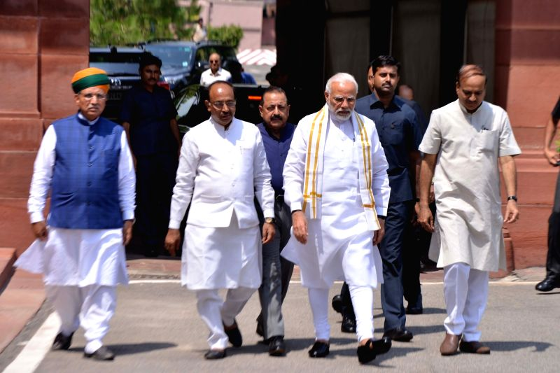 Prime Minister Narendra Modi arrives at Parliament House along with Union Ministers Ananth Kumar, Jitendra Singh, Vijay Goel and Arjun Ram Meghwal ahead of the Monsoon Session in New Delhi ... - Narendra Modi, Ministers Ananth Kumar, Jitendra Singh, Vijay Goel and Arjun Ram Meghwal