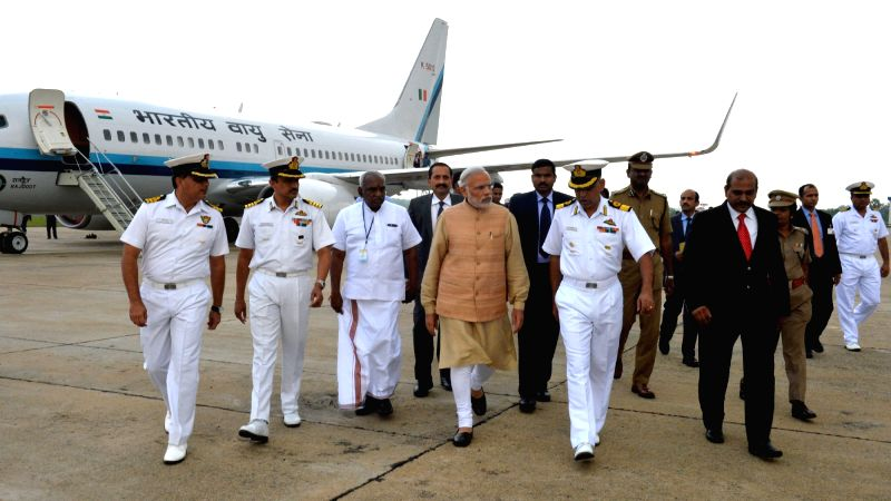 Prime Minister Narendra Modi arrives at INS Rajali, in Arakkonam, Tamil Nadu on Dec 3, 2015. Also seen Union Minister of State for Road Transport and Highways and Shipping P. Radhakrishnan. - Narendra Modi