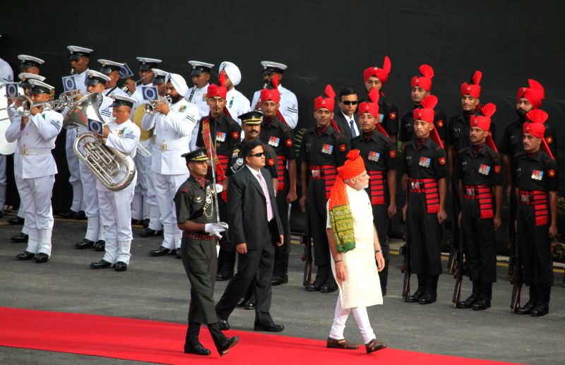 Prime Minister Narendra Modi arrives at Red Fort to hoist the national flag and address the nation on Independence Day in New Delhi on Aug 15, 2014. - Narendra Modi