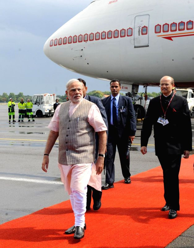 Prime Minister Narendra Modi arrives at Tegel Military Airport in Berlin, Germany on July 13, 2014. Prime Minister is on his way to attend the BRICS Summit in Brazil. Also seen Vijay Gokhale.