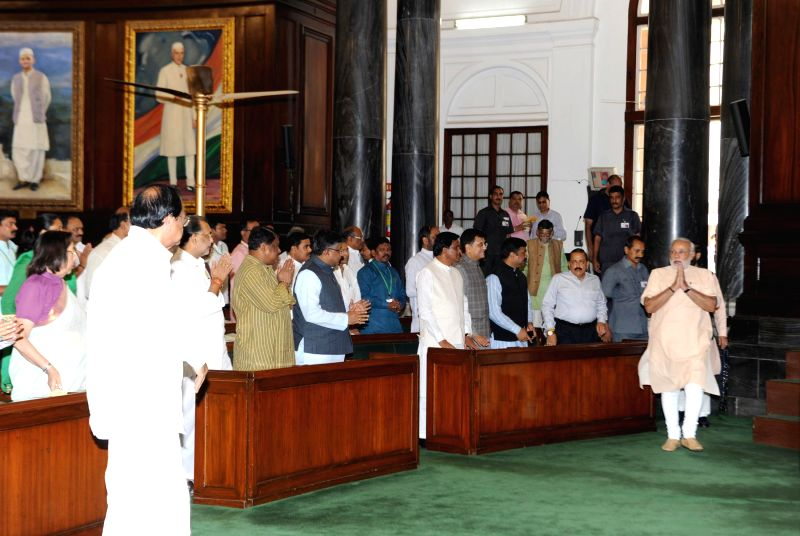 Prime Minister Narendra Modi arrives at the Central Hall of the Parliament to attend BJP Parliamentary Party meeting in New Delhi on July 31, 2014. - Narendra Modi