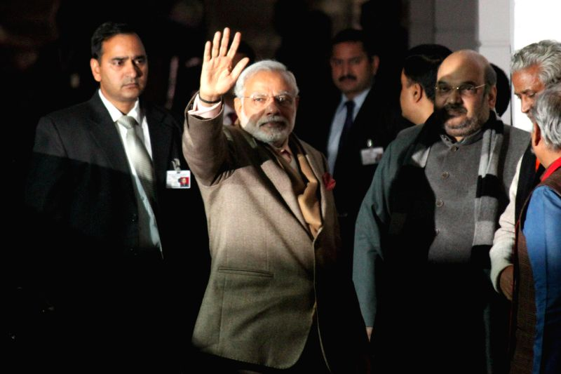 Prime Minister Narendra Modi arrives at the BJP headquarter to attend BJP parliamentary board meeting in New Delhi on Jan 19,2015. - Narendra Modi