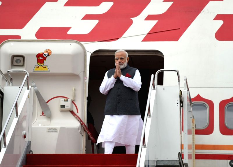 Prime Minister Narendra Modi arrives in Astana, Kazakhstan, to attend the Shanghai Cooperation Organisation Summit on June 8, 2017. - Narendra Modi
