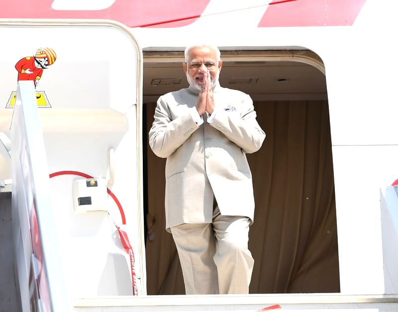 Prime Minister Narendra Modi arrives in Kampala, Uganda for second leg of his three-nation state visit to Rwanda, Uganda and South Africa, on July 24, 2018. - Narendra Modi