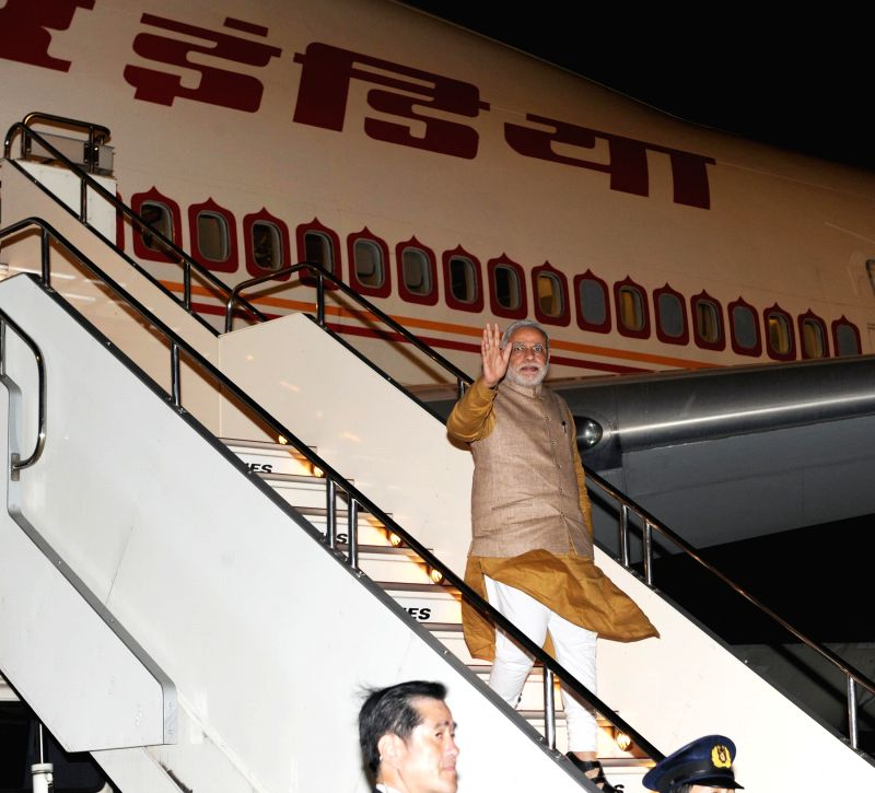 Prime Minister Narendra Modi arrives in Tokyo, Japan to hold annual summit meeting with his Japanese counterpart Shinzo Abe on Aug 31, 2014. - Narendra Modi