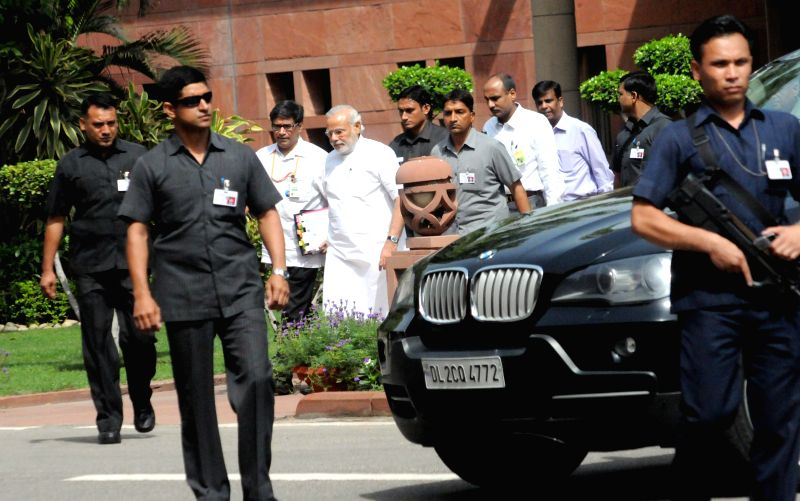 Prime Minister Narendra Modi arrives to attend the budget session of the Parliament in New Delhi on July 7, 2014. - Narendra Modi
