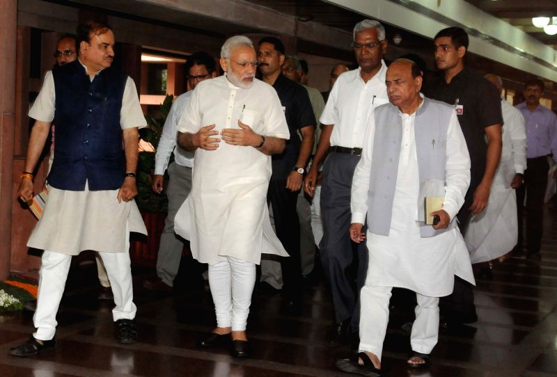 Prime Minister Narendra Modi arrives to attend the All Party meeting in New Delhi on July 17, 2016. Also seen Union Minister for Chemicals & Fertilizers and Parliamentary Affairs ... - Narendra Modi and Affairs Ananth Kumar