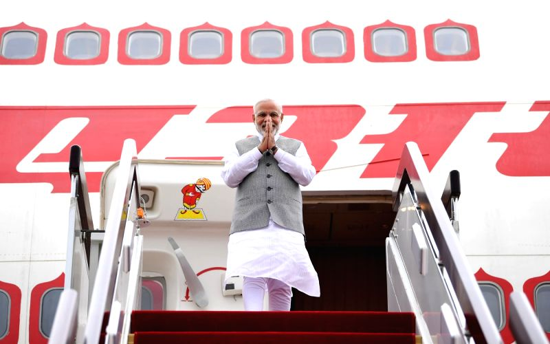 Prime Minister Narendra Modi arrives to attend the Shanghai Cooperation Organisation (SCO) summit in Qingdao, China on June 9, 2018. - Narendra Modi