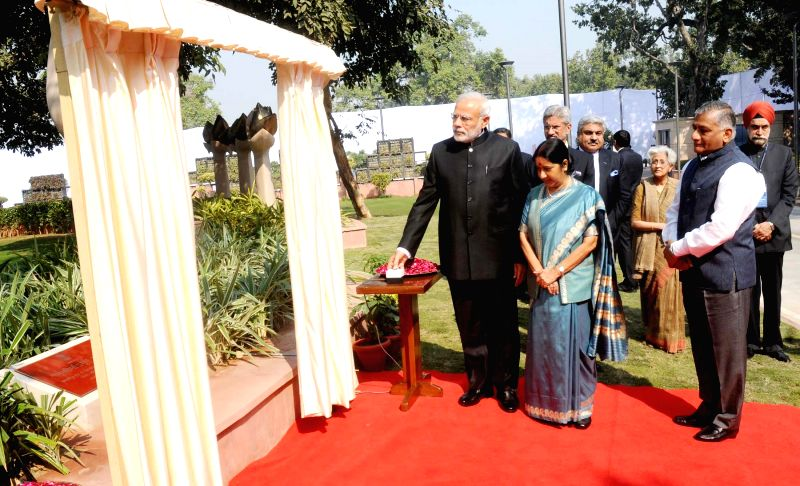 Prime Minister Narendra Modi arrives to unveil a plaque to commemorate officers who laid down their lives in national service at Heads of Missions Conference, in New Delhi on Feb 7, 2015. Also seen .. - Narendra Modi, Sushma Swaraj and K. Singh