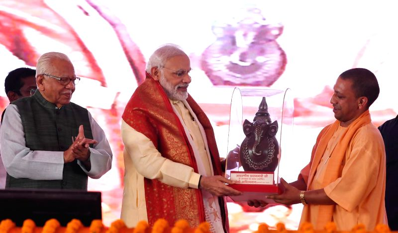 Prime Minister Narendra Modi at the foundation stone laying ceremony of Poorvanchal Expressway in Azamgarh, Uttar Pradesh on July 14, 2018. Also seen Uttar Pradesh Governor Ram Naik and ... - Narendra Modi