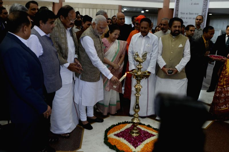 Prime Minister Narendra Modi at the inauguration of an exhibition on making of the Constitution by the Constituent Assembly, at Parliament Library, in New Delhi on Nov 26, 2015. Also seen Lok Sabha ... - Narendra Modi, M. Venkaiah Naidu and Sumitra Mahajan