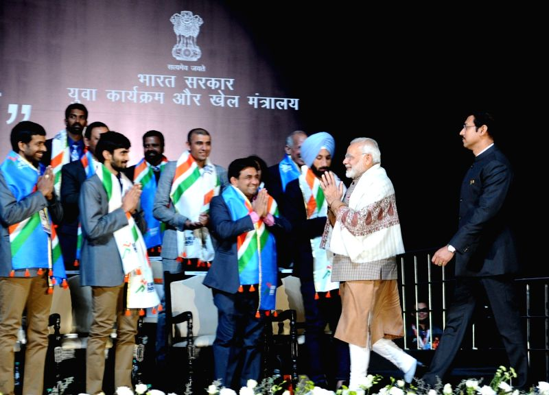 Prime Minister Narendra Modi at the inauguration of the first edition of Khelo India School Games at the Indira Gandhi Indoor Stadium in New Delhi on Jan 31, 2018. Also seen MoS for Youth ... - Narendra Modi and Rajyavardhan Singh Rathore