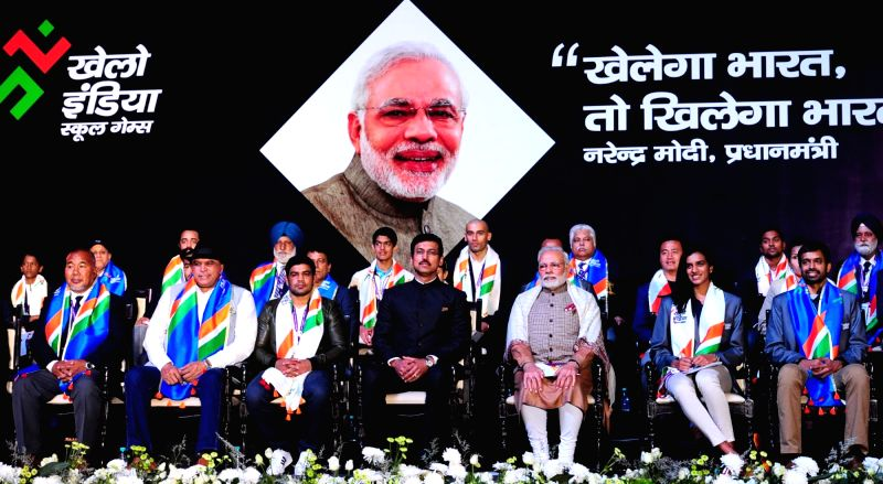 Prime Minister Narendra Modi at the inauguration of the first edition of Khelo India School Games at the Indira Gandhi Indoor Stadium in New Delhi on Jan 31, 2018. Also seen MoS for Youth ... - Narendra Modi, Rajyavardhan Singh Rathore and Sushil Kumar