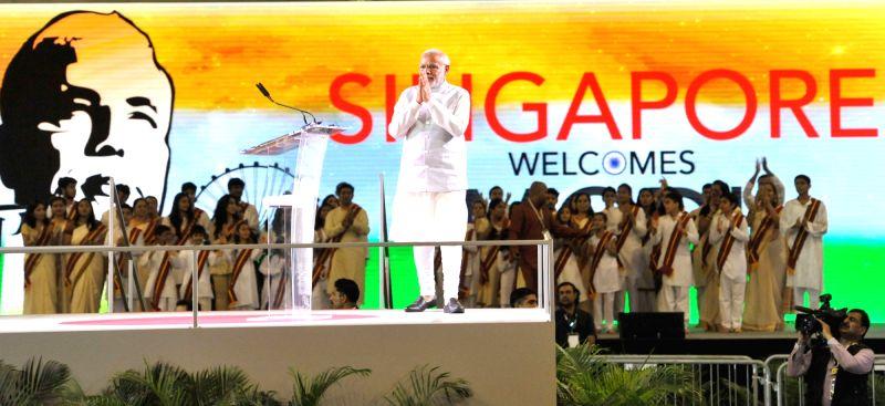Prime Minister Narendra Modi at the Indian Community reception event, at Singapore Expo, Singapore on Nov. 24, 2015. - Narendra Modi