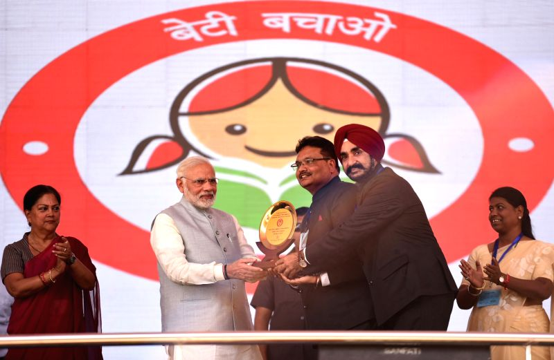 Prime Minister Narendra Modi at the launch of expansion of Beti Bachao Beti Padhao and National Nutrition Mission in Jhunjhunu, Rajasthan on March 8, 2018. - Narendra Modi