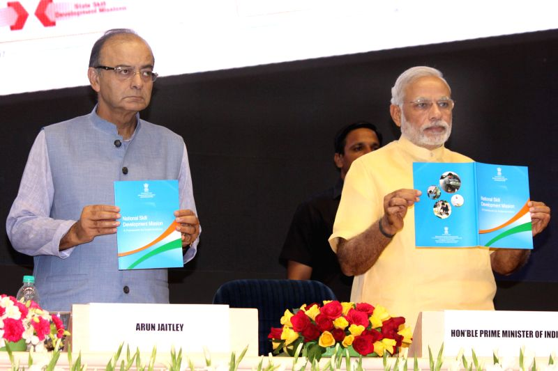 Prime Minister Narendra Modi at the launch of the Skill India Mission, on the occasion of the World Youth Skills Day, in New Delhi on July 15, 2015. Also seen the Union Minister Arun ... - Narendra Modi and Arun Jaitley