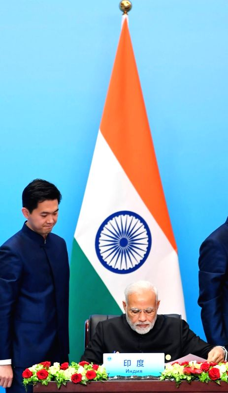 Prime Minister Narendra Modi at the Signing Ceremony of the Shanghai Cooperation Organisation (SCO) Summit, in Qingdao, China on June 10, 2018. - Narendra Modi