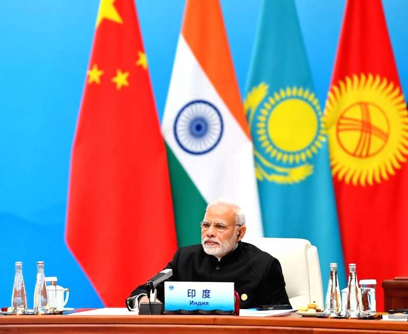Prime Minister Narendra Modi attends the Plenary Session of the Shanghai Cooperation Organisation (SCO) Summit in Qingdao, China on June 10, 2018. - Narendra Modi