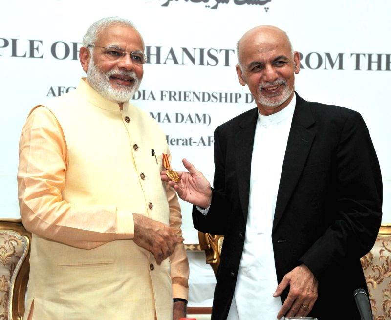 Prime Minister Narendra Modi being conferred on the Highest Civilian Honour of Afghanistan (Amir Amanullah Khan Award) by the President of the Islamic Republic of Afghanistan Mohammad Ashraf ... - Narendra Modi and Amanullah Khan Award