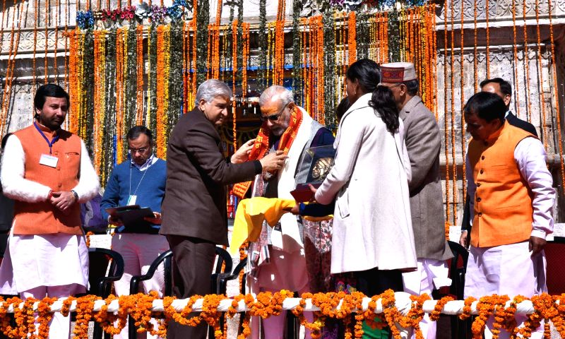 Prime Minister Narendra Modi being felicitated by Uttarakhand Governor K.K. Paul on his visit to Kedarnath, in Uttarakhand on Oct 20, 2017. - Narendra Modi